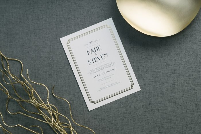 Deco Wedding Invitation Hot Foil Stamped in Antique Gold on White Pearl Card