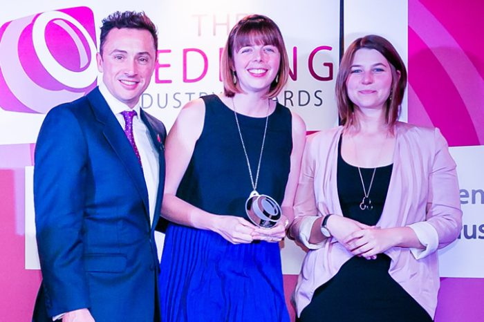 Wendy and Kasia collecting our trophy from founder of The Wedding Industry Awards, Damian Bailey on behalf of the team at The Foil Invite Company.