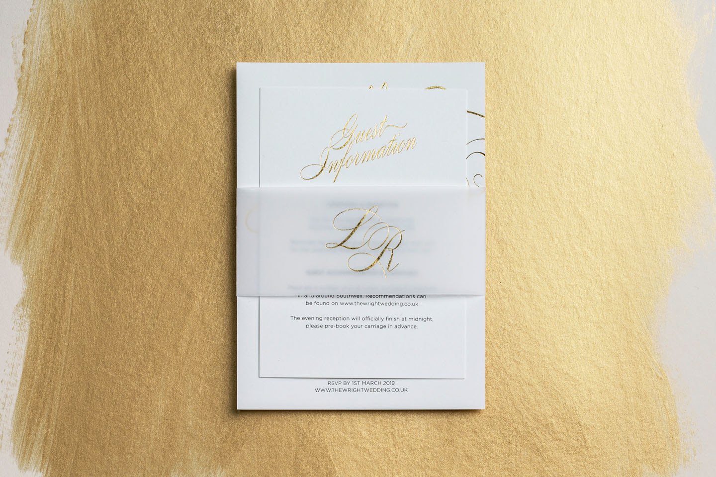Gold foil wedding stationery set with vellum belly band